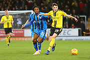 Burton Albion Reece Hutchinson (19) and Gillingham FC midfielder Regan Charles-Cook (11) during the EFL Sky Bet League 1 match between Burton Albion and Gillingham at the Pirelli Stadium, Burton upon Trent, England on 12 January 2019.