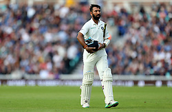 India's Cheteshwar Pujara walks of the field after being caught by England's Jonny Bairstow (not in picture) during the test match at The Kia Oval, London.