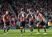 Bournemouth players celebrate  after Bournemouth Defender Tommy Elphick (5) scores to make it 1-2 during the Barclays Premier League match between Bournemouth and Chelsea at the Goldsands Stadium, Bournemouth, England on 23 April 2016. Photo by Adam Rivers.