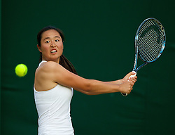 LONDON, ENGLAND - Saturday, June 28, 2014: Qiu Yu Ye (CHN) during the Girls' Singles 1st Round match on day six of the Wimbledon Lawn Tennis Championships at the All England Lawn Tennis and Croquet Club. (Pic by David Rawcliffe/Propaganda)