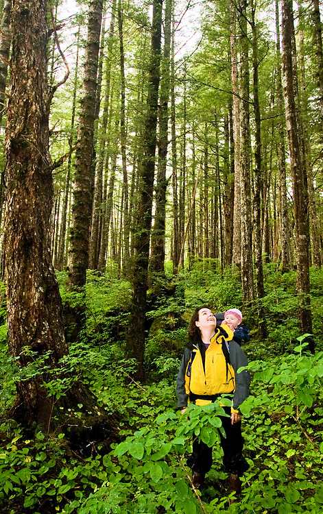 A mother and daughter hike through the magestic old-growth forest. MR