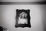 Egypt, Cairo: a religious icon of Jesus Christ hanged on a wall in a private house inside Mokattam area.