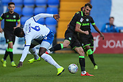Tranmere Rovers Emmanuel Monthe(6) and Forest Green Rovers Christian Doidge(9) during the EFL Sky Bet League 2 play off first leg match between Tranmere Rovers and Forest Green Rovers at Prenton Park, Birkenhead, England on 10 May 2019.
