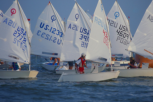 Stock photo of a group of sailboats on the water
