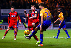 Jordan Cook of Grimsby Town sticks a leg out to block an pass from Ryan Sweeney of Mansfield Town - Mandatory by-line: Ryan Crockett/JMP - 06/11/2018 - FOOTBALL - One Call Stadium - Mansfield, England - Mansfield Town v Grimsby Town - Sky Bet League Two