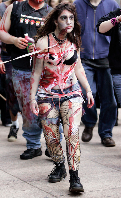 "-October 25, Boston, MA-..Sophia Goutzinos, 19, of Boston walks with dozens of other zombie fans during the Zombie March through Boston on Sunday afternoon.  The group of dozens of zombies met at South Station and wandered through Downtown Crossing, the Common, and Government Center, accompanied by cries of ""Brains!"" and guttural moans...(Photo by Brooks Canaday)"