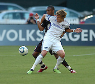 DC United defender Rodney Wallace (in Black) and Kansas City midfielder Chance Myers battle for possession during their team's MLS match at RFK Stadium in Washington DC. United defeated the Wizards 2-1 to earn their first points of the season.