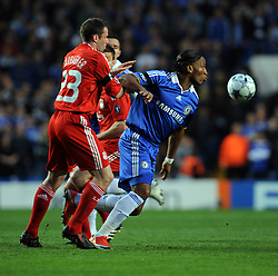 Didier Drogba of Chelsea and Jamie Carragher of Liverpool compete for the ball during the UEFA Champions League Quarter Final Second Leg match between Chelsea and Liverpool at Stamford Bridge on April 14, 2009 in London, England.