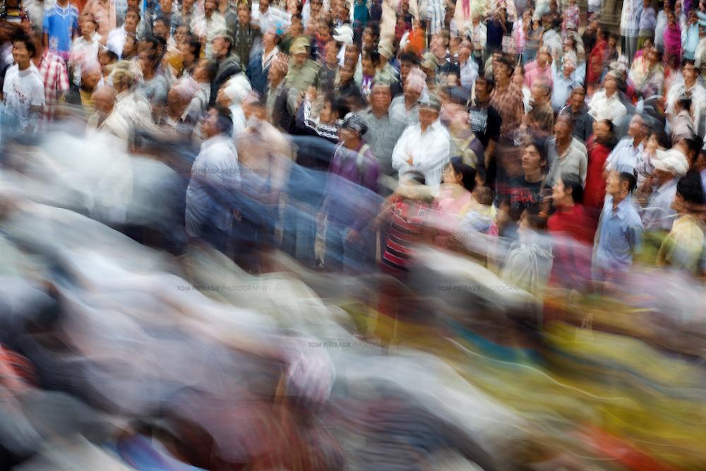 Crowds gather at Pathan Durbar Square in Kathmandu for an annual chariot procession to honour the Hindu god Macchindra Nath. ..Photo: Tom Pietrasik.Kathmandu, Nepal.April 18th 2010