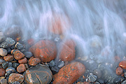 Waves crashing on rocks along Lake Superior<br />