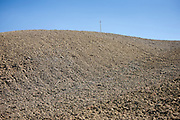 Telegraph pole in barren landscape at Murlo in Tuscany, Italy