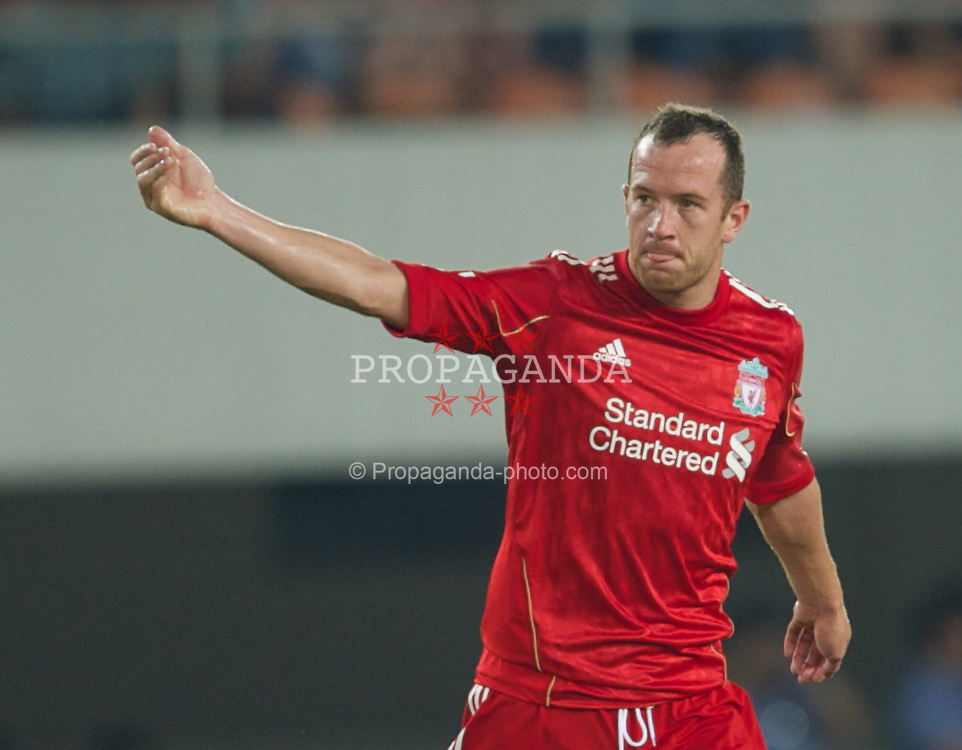 GUANGZHOU, CHINA - Wednesday, July 13, 2011: Liverpool's new signing Charlie Adam in action against Guangdong Sunray Cave during the first pre-season friendly on day three of the club's Asia Tour at the Tianhe Stadium. (Photo by David Rawcliffe/Propaganda)