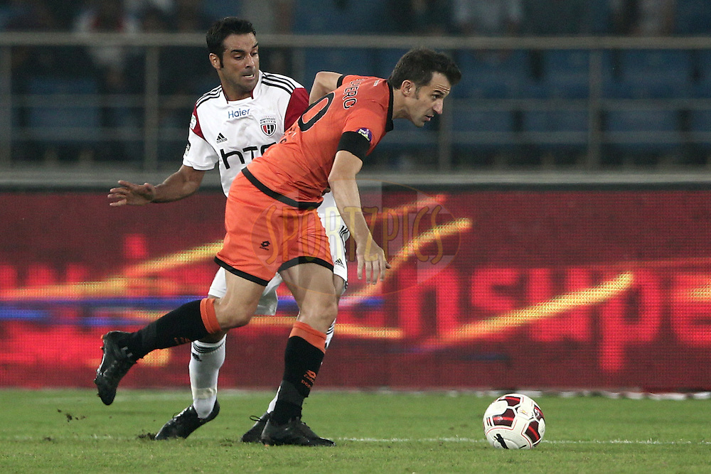 Alessandro Del Piero of Delhi Dynamos FC run with ball against Miguel Garcia of NorthEast United FC during match 16 of the Hero Indian Super League between The Delhi Dynamos FC and NorthEast United FC held at the Jawaharlal Nehru Stadium, Delhi, India on the 29th October 2014.<br /> <br /> Photo by:  Deepak Malik/ ISL/ SPORTZPICS