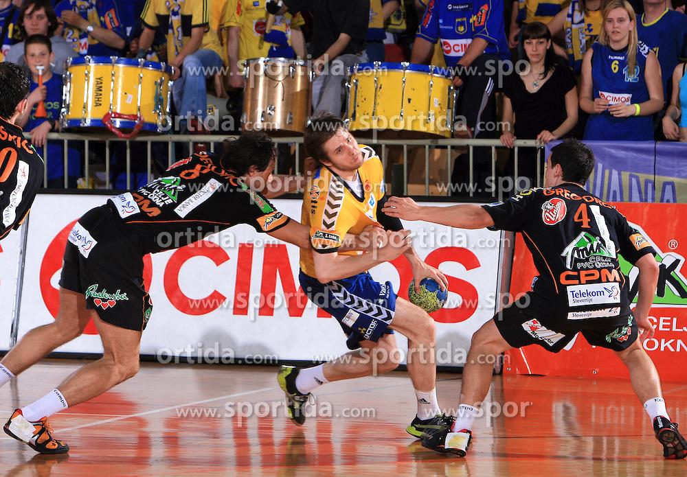 Branko Bedekovic vs Milan Mirkovic of Cimos at Final match of Slovenian Men Handball Cup between RK Cimos Koper and RK Celje Pivovarna Lasko, on April 19, 2009, in Arena Bonifika, Koper, Slovenia. Cimos Koper won 24:19 and became Slovenian Cup Champion. (Photo by Vid Ponikvar / Sportida)