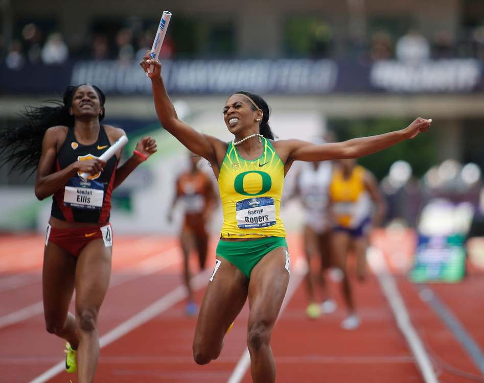 Oregon's Raevyn Rogers celebrates as she crosses the fnish line ahead of USC's Kendall Ellis to win the women's 4x400 meters relay in the time of 3 minutes, 23.13 seconds on the final day of the NCAA outdoor college track and field championships in Eugene, Ore., Saturday, June 10, 2017. Oregon's win in the relay secured them the team championship. (AP Photo/Timothy J. Gonzalez)