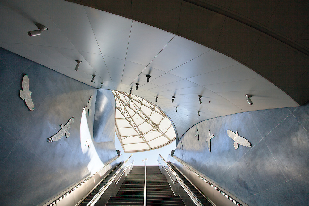 Ceilings Plus Illusions® ceiling panels take flight above the entrance to the Soto Station of the Los Angeles Metro Gold Line. The flat metal panels appear curved, relating them to the soaring canopy overhead and the birds-in-flight artwork in the station.