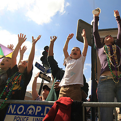 24 February 2009: Scenes from the Rex parade as it rolled along the St. Charles Avenue parade route throwing beads, and various trinkets on Mardi Gras day in New Orleans, Louisiana. Mardi Gras is an annual celebration that ends at midnight with the start of the Catholic Lenten season which begins with Ash Wednesday and ends with Easter..