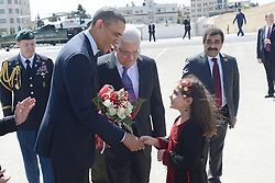 U.S. President Barack Obama receives flowers from a Palestinian child during a welcoming ceremony upon his arrival in the West Bank city of Ramallah on March 21, 2013.. Obama arrived in Tel Aviv in Israel Wednesday to start his Mideast tour. Obama will spend three days in Israel, the Palestinian territories and Jordan, March 21, 2013. Photo by Imago / i-Images...UK ONLY.