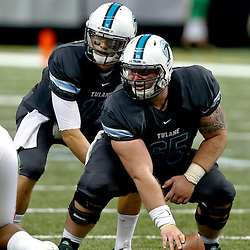 Sep 7, 2013; New Orleans, LA, USA; Tulane Green Wave quarterback Nick Montana (11) under center Zach Morgan(65) during the first quarter of a game against the South Alabama Jaguarsat the Mercedes-Benz Superdome. Mandatory Credit: Derick E. Hingle-USA TODAY Sports