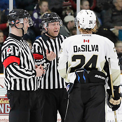 TRENTON, - Apr 2, 2016 -  Ontario Junior Hockey League game action between the Trenton Golden Hawks and the Kingston Voyageurs. Game 3 of the North East Champonship series, OHA Referees speak with Jordan Dasilva #24 of the Trenton Golden Hawks during the third period at the Duncan Memorial Gardens, ON. (Photo by Amy Deroche / OJHL Images)