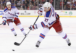 Mar 6; Newark, NJ, USA; New York Rangers defenseman Ryan McDonagh (27) takes a shot during the first period of their game against the New Jersey Devils at the Prudential Center.