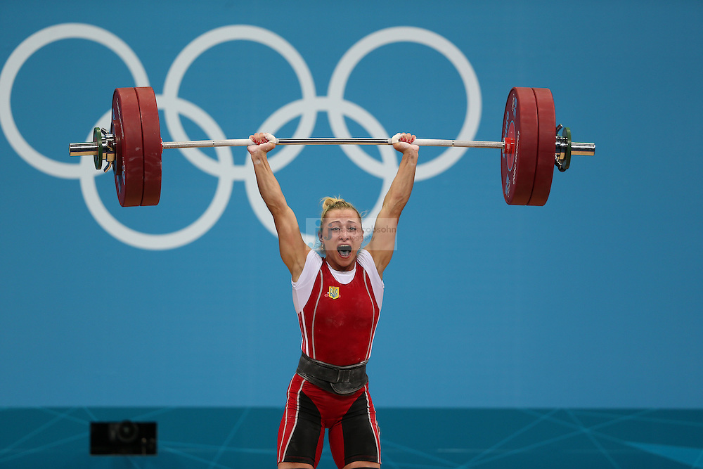 Yuliya Kalina of Ukraine lifts 129 kg during the women's 58kg weightlifting event during day 3 of the London Olympic Games London, 30 Jul 2012..(Jed Jacobsohn/for The New York Times)....