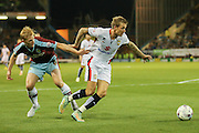 Burnley defender Ben Mee gets hold of Milton Keynes Dons midfielder Carl Baker during the Sky Bet Championship match between Burnley and Milton Keynes Dons at Turf Moor, Burnley, England on 15 September 2015. Photo by Simon Davies.