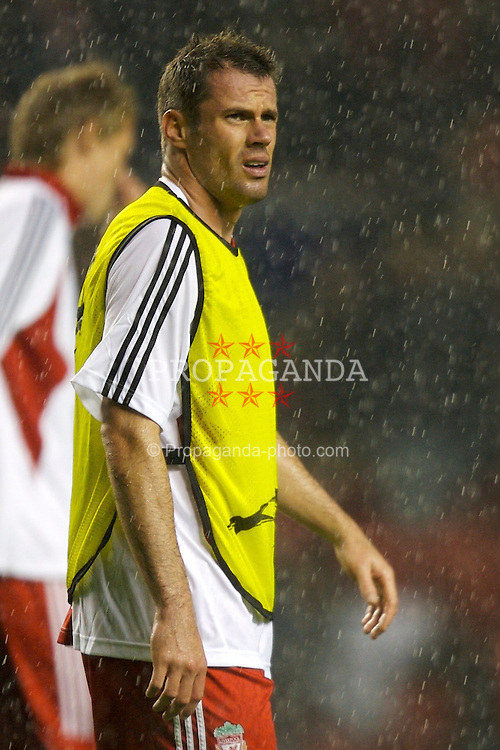 Liverpool, England - Wednesday, October 3, 2007: Liverpool's Jamie Carragher warms-up in the rain before the UEFA Champions League Group A match against Olympique de Marseille at Anfield. (Photo by David Rawcliffe/Propaganda)