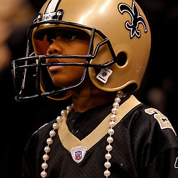 January 2, 2011; New Orleans, LA, USA; A young New Orleans Saints fan watches from the stands during the first quarter of a game against the Tampa Bay Buccaneers at the Louisiana Superdome. Mandatory Credit: Derick E. Hingle