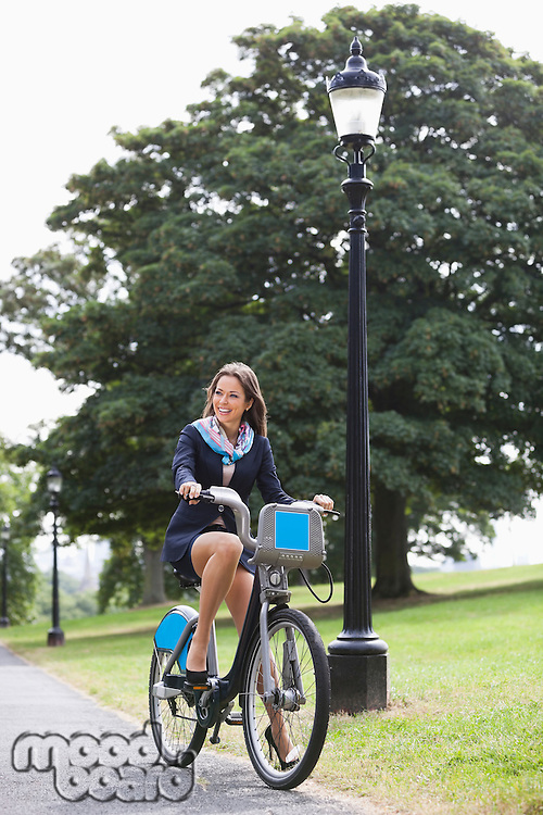Young businesswoman commuting by her bicycle