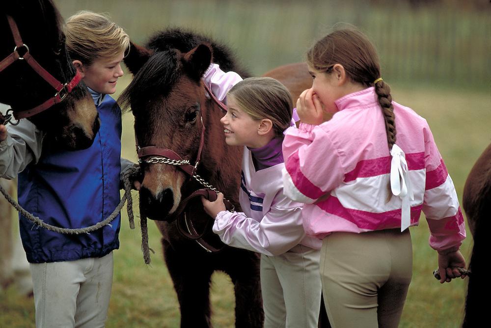 Girls with ponies at Far Hills Race Meet, Far Hills, NJ