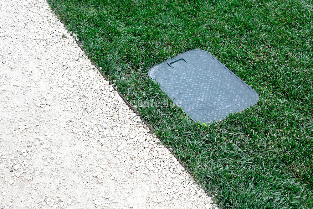 edge of grass with watering tap put cover