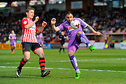 Exeter City's David Wheeler and Plymouth Argyle's Peter Hartley during the Sky Bet League 2 match between Exeter City and Plymouth Argyle at St James' Park, Exeter, England on 2 April 2016. Photo by Graham Hunt.