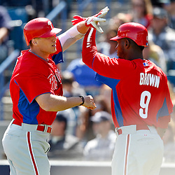 March 4, 2012; Tampa Bay, FL, USA; Philadelphia Phillies right fielder Hunter Pence (3) celebrates with teammate right fielder Domonic Brown (9) following a homerun against the New York Yankees during spring training game at George M. Steinbrenner Field. Mandatory Credit: Derick E. Hingle-US PRESSWIRE