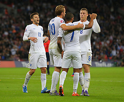 Theo Walcott ( 2nd R ) of England celebrates with team mates after he scores the opening goal - Mandatory byline: Paul Terry/JMP - 07966 386802 - 09/10/2015 - FOOTBALL - Wembley Stadium - London, England - England v Estonia - European Championship Qualifying - Group E