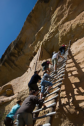Park visitors climb a 36 foot ladder into the entrance of the Balcony House ruins, Mesa Verde National Park, near Cortez, Colorado.