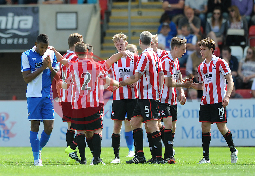 Christian Montano of Bristol Rovers cuts a dejected figure as Billy Waters of Cheltenham Town celebrates with team mates after scoring - Mandatory by-line: Dougie Allward/JMP - 25/07/2015 - SPORT - FOOTBALL - Cheltenham Town,England - Whaddon Road - Cheltenham Town v Bristol Rovers - Pre-Season Friendly