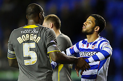 Jobi McAnuff (JAM) of Reading greets Wes Morgan (ENG) of Leicester City after the match finishes in a 1-1 draw - Photo mandatory by-line: Rogan Thomson/JMP - 07966 386802 - 14/04/2014 - SPORT - FOOTBALL - Madejski Stadium, Reading - Reading v Leicester City - Sky Bet Football League Championship.