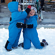 Brothers Jackson Foot, Left, Eighteen months and Harrison Foot, 3, on holiday from the Hunter Valley, NSW, Australia,  enjoy the opening day of the Ski season in Queenstown at Coronet Peak which  opened thanks to snow making machines. Coronet Peak, Queenstown,  South Island, New Zealand, 30th June 2011