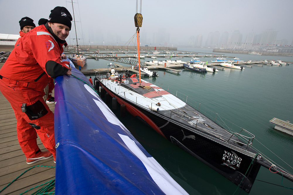 30JAN09. PUMA Ocean Racing's Il Mostro is lifted out of the water in Qingdao. The shore crew will work on the boat in readiness for the in port race and the next leg to Rio de Janeiro.