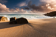 Dramatic Autumnal evening light over perfect wave-smoothed sand in West Penwith, Cornwall.