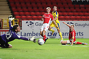 AFC Wimbledon midfielder Scott Wagstaff (7) with a shot on goal during the EFL Trophy match between Charlton Athletic and AFC Wimbledon at The Valley, London, England on 4 September 2018.