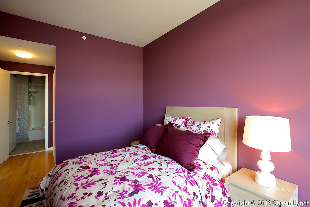 A purple master bedroom located inside a model apartment at the Queens West Building 2 in Long Island City, New York.