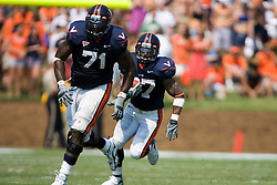 Virginia guard Branden Albert (71) clears a path for Cedric Peerman (37).  The Virginia Cavaliers defeated the Duke Blue Devils 23-14 at Scott Stadium in Charlottesville, VA on September 8, 2007  With the loss, Duke extended their longest-in-the-nation losing streak to 22 games.