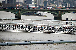 © Licensed to London News Pictures. 09/01/2017. London, UK. Commuters queue up for a river ferry on the London Eye Pier as a 24 hour London Underground tube strike takes hold.  All Zone one tube stations are closed until 6PM tonight after members of the RMT and the Transport Salaried Staffs' Association unions walked out after talks with TFL collapsed.  Photo credit: Peter Macdiarmid/LNP