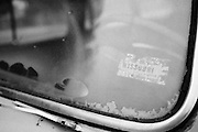 A Missouri registration sticker on the windshield of an old vehicle. Missoula Photographer