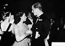 Princess Elizabeth dancing with her fiance, Lieutenant Philip Mountbatten, RN, at the Assembly Rooms, Edinburgh, when a ball was held to welcome the royal family to Scotland.
