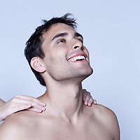 studio shot on isolated background of a handsome man having a massage