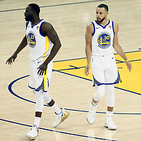 OAKLAND, CA - MAY 31: Stephen Curry #30 of the Golden State Warriors is seen next to Draymond Green #23 of the Golden State Warriors in Game One of the 2018 NBA Finals won 124-114 in OT by the Golden State Warriors over the Cleveland Cavaliers at the Oracle Arena on May 31, 2018 in Oakland, California. NOTE TO USER: User expressly acknowledges and agrees that, by downloading and or using this photograph, User is consenting to the terms and conditions of the Getty Images License Agreement. Mandatory Copyright Notice: Copyright 2018 NBAE (Photo by Chris Elise/NBAE via Getty Images)