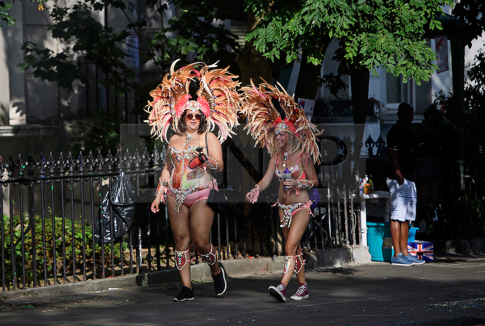 © Licensed to London News Pictures. 29/08/2016. London, UK. Carnival goers in costume, making their way to day two of the Notting Hill carnival, the second largest street festival in the world after the Rio Carnival in Brazil, attracting over 1 million people to the streets of West London.  Photo credit: Ben Cawthra/LNP